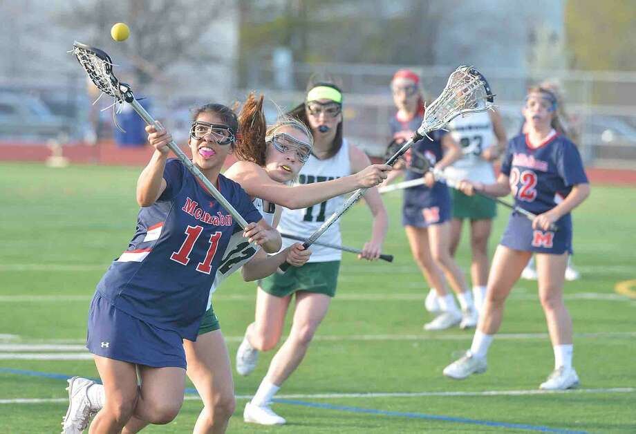 Brein McMahons #11 Katherin Martinez during girls lacrosse action for the Kuchta Cup at Norwalk High School on Tuesday April 19 2016 in Norwalk Conn.