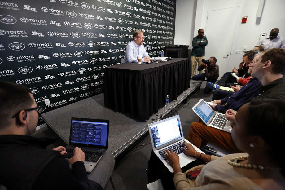 New York Jets general manager Mike Maccagnan,top center, speaks to reporters ahead of the NFL football draft, during a news conference, Friday, April 24, 2015, in Florham Park, N.J. (AP Photo/Julio Cortez)