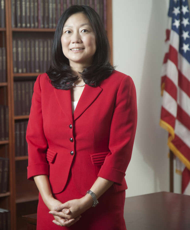 In this 2013 photo, U.S. District Judge Lucy Koh poses for a picture, in San Francisco. Koh has become increasingly frustrated during the first few days of the trial pitting Apple against Samsung because personal Wi-Fi signals interfere with an internal network she relies on for a real-time transcript of the proceedings. (AP Photo/The Recorder, Jason Doiy)
