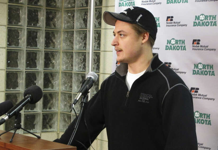 In this April 2, 2014 photo, University of North Dakota hockey player Connor Gaarder, a junior from Edina, Minn., answers questions at a news conference in Grand Forks, N.D. Gaarder is a walk-on who is tied for third on the team in game-winning goals this season. He has become one of the team's favorite supporting cast members in a season that will culminate in this week's Frozen Four hockey tournament beginning April 9 in Boston. (AP Photo/Dave Kolpack)