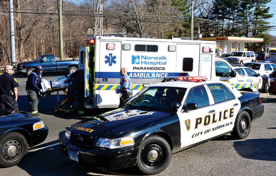 Hour photo / Erik Trautmann A pedestrian was struck by a motor vehicle Wednesday morning outside the CT Department of Motor Vehicle.
