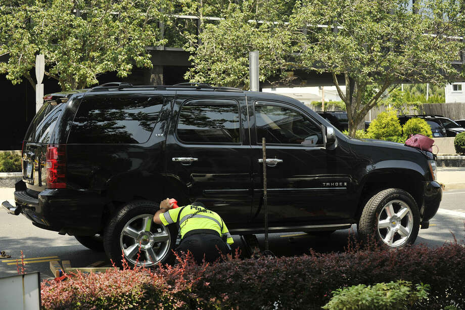 Emergency personnel gather at the scene where a pedestrian was struck by a SUV at the eastern corner of Summer Street on Hoyt Street in Stamford, Conn., on Monday, July 21, 2014. Police say the pedestrian suffered life threatening injuries.(Photo:Jason Rearick)