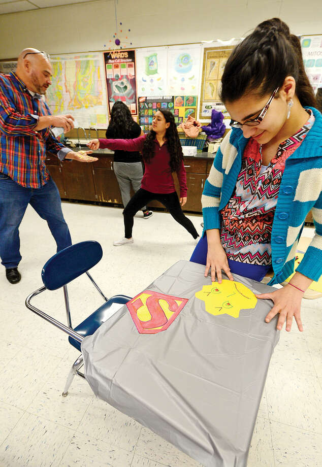 """Hour photo / Erik Trautmann West Rocks Middle School 8th grader Pervi Triventi make her Kindness Hero cape during a program titled """"Safe, Peaceful and Non-Violent West Rocks Community"""" Friday morning. The program is a part of Positive Behavior Intervention Supports (PBIS), a statewide program to encourage positive behavior in students."""