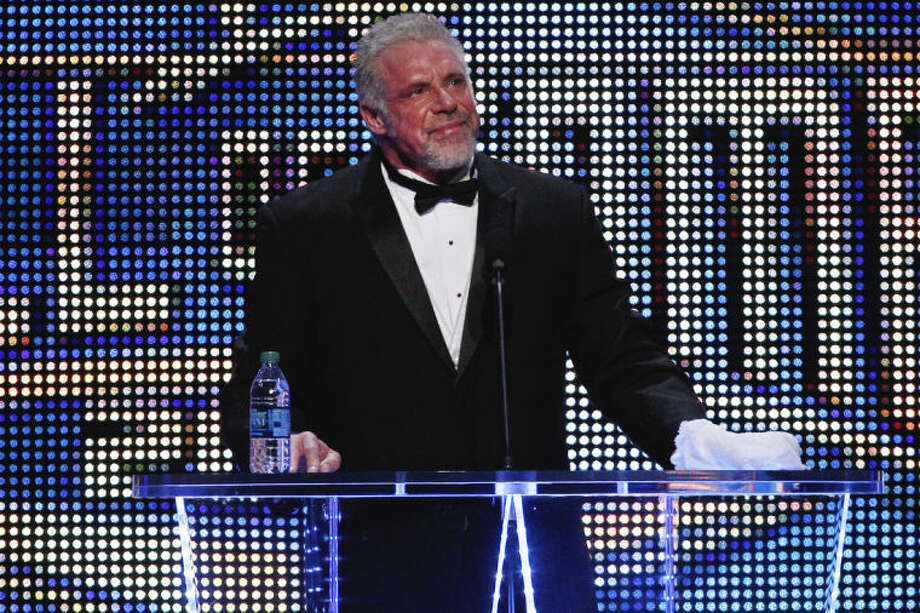 FILE - In this April 5, 2014 file photo provided by the WWE, James Hellwig, aka The Ultimate Warrior, speaks during the WWE Hall of Fame Induction at the Smoothie King Center in New Orleans. The WWE said Hellwig, one of pro wrestling's biggest stars in the late 1980s, died Tuesday, April 8, 2014. He was 54. (Jonathan Bachman/AP Images for WWE, File)