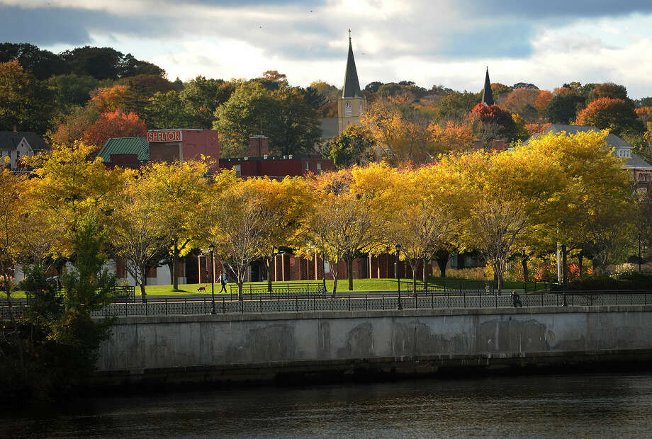"""Shelton City Riverfront Park, occupying the former factory site known as """"The Slab"""", is now a popular walking spot on the Housatonic River in downtown Shelton, Conn. on Sunday, October 26, 2014."""