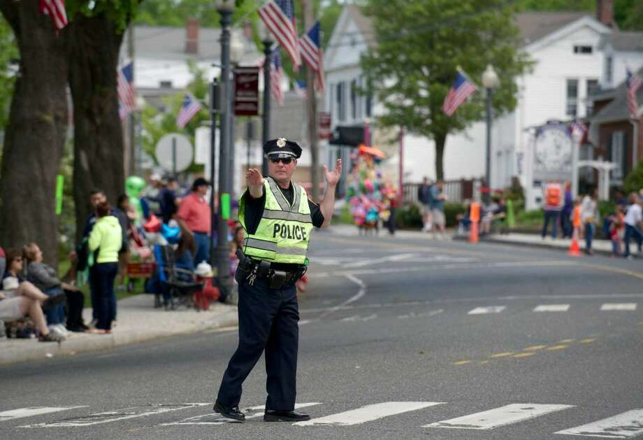 The Annual Memorial Day Parade makes its way through downtown Bethel, Conn, on Sunday afternoon, May 18, 2014. Consisting of marching bands, military vehicles, sports teams, scouts, veterans and more the parade ended at the Hurgin Municipal Center where services were held on the front steps.