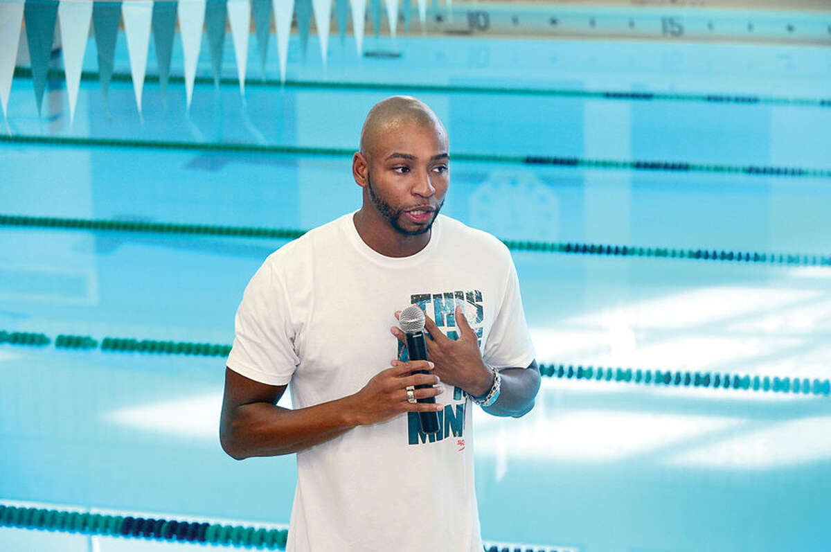 Hour photo / Erik Trautmann Former USOlympic swimmer Cullen Jones talked to young swimmers during a swim clinic for Norwalk High School and the Zeus Swim teams at the Spinola Natatorium Saturday.