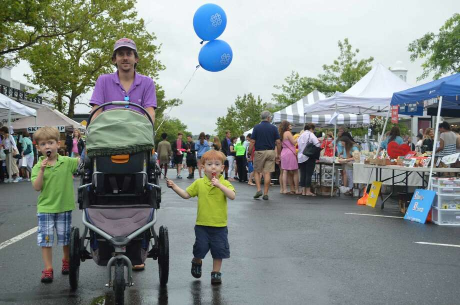 The Kerchoff family of New Canaan attend the sidewalk sales. From left, Avery, 4, dad Mark, and Myler, 2.