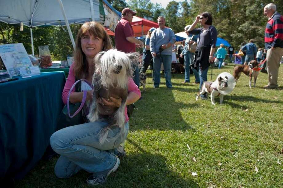 "Andrea Dener of Wilton holds Mimi, a Chinese Crested breed dog at the fourth annual ""Bark in the Park"" dog walk and festival on Saturday Sept. 17, 2011 at Cranbury Park in Norwalk Conn."