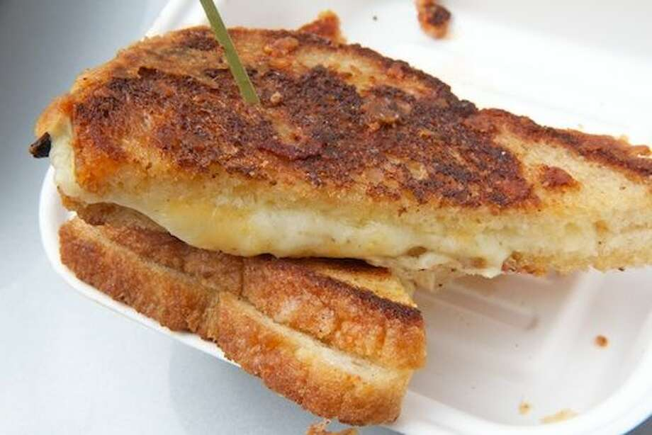 """Melt Mobile serves everything from a deliciously simple grilled cheese to its """"Insanewich,"""" a burger encased in two grilled cheese sandwiches. The truck can be found from Stamford to Norwalk. It donates two percent of its proceeds to the Umbrella Club, a local charitable organization devoted to helping under privileged people and children in need."""