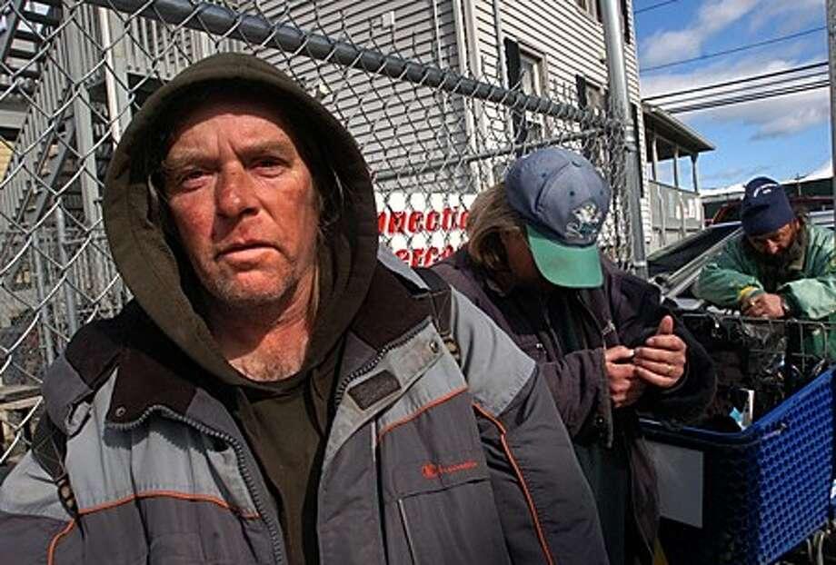 Homeless residents like John wait outside the Norwalk Emergency Shelter on Merritt St for access to food and shelter. Hour photo / Erik Trautmann
