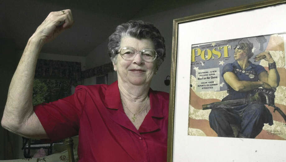 "AP file photo/Jim ColeIn this May 22, 2002, file photo, Mary Doyle Keefe poses at her home in Nashua, N.H., with the May 29, 1943, cover of the Saturday Evening Post for which she had modeled as ""Rosie the Riveter"" in a Norman Rockwell painting. Keefe died Tuesday, April 21, in Simsbury, Conn., after a brief illness. She was 92."