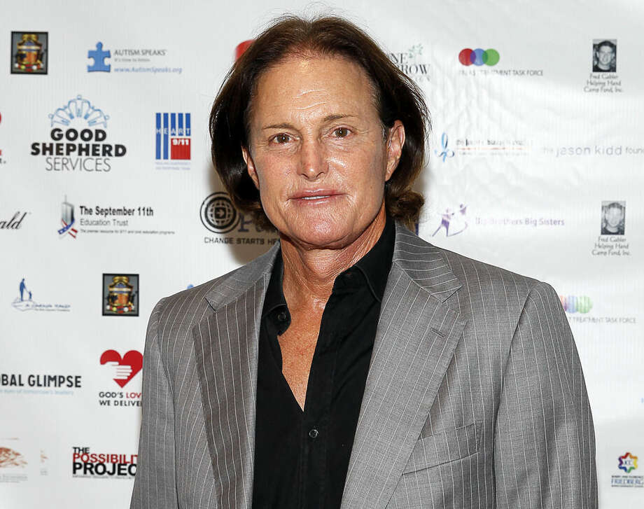 FILE - In this Sept. 11, 2013 file photo, former Olympic athlete Bruce Jenner arrives at the Annual Charity Day hosted by Cantor Fitzgerald and BGC Partners, in New York. Jenner was sued in Los Angeles on Friday, May 1, 2015, by the stepchildren of Kim Howe, a woman who died after Jenner's sport utility vehicle pushed her car into oncoming traffic in a collision on Pacific Coast Highway in February 2015. (Photo by Mark Von Holden/Invision/AP, File)