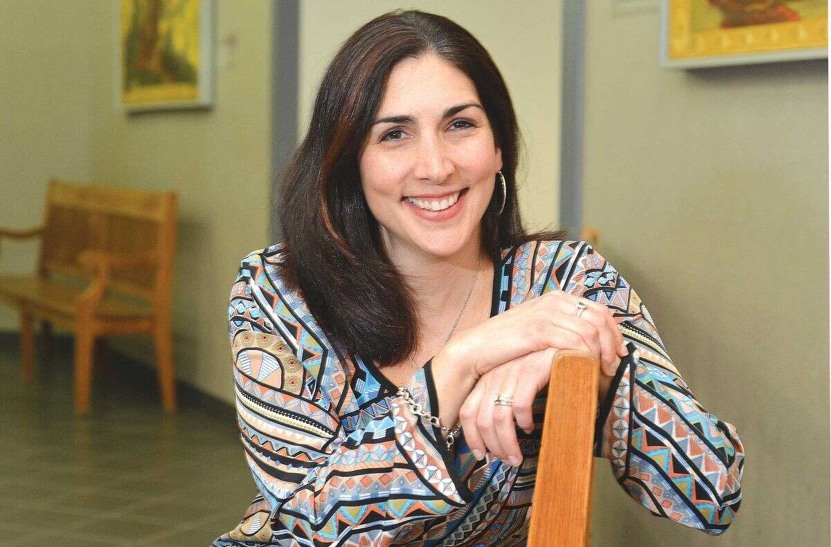 Hour photo/Alex von Kleydorff Principal of Columbus Magnet School, Emily Lopez, plans to step down in June to become Executive Director of Programs for the LilySarahGrace Fund.