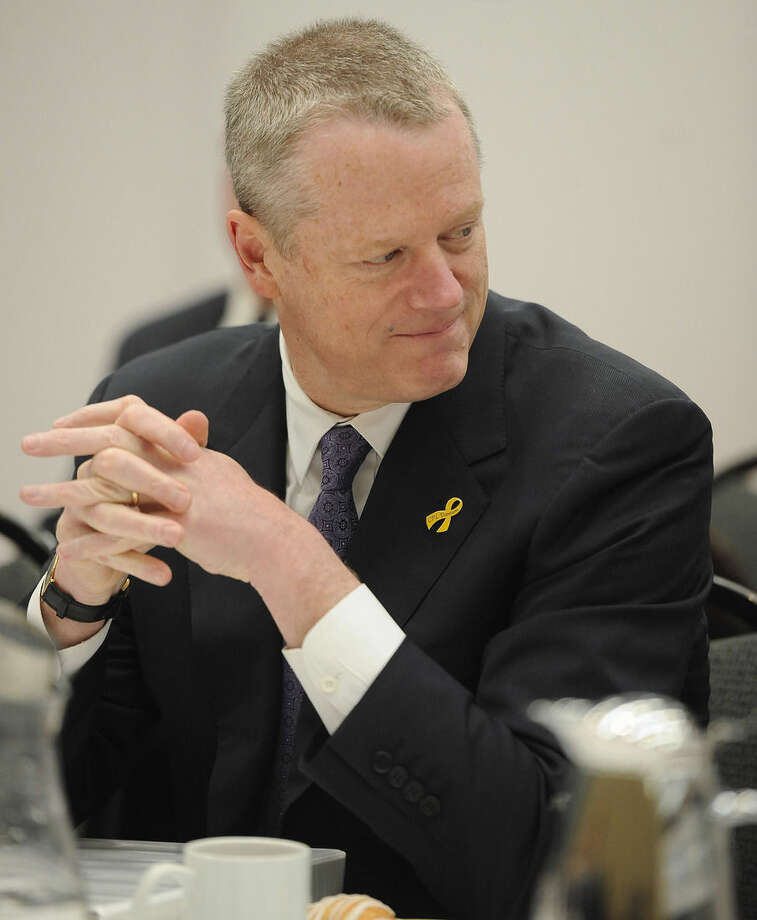Massachusetts Gov. Charlie Baker, listens during a private lunch with New England governors, Thursday, April 23, 2015, in Hartford, Conn. New England's governors met Thursday to update their long-term energy strategy that increasingly relies on natural gas and efforts to build more pipelines. (AP Photo/Jessica Hill, Pool)