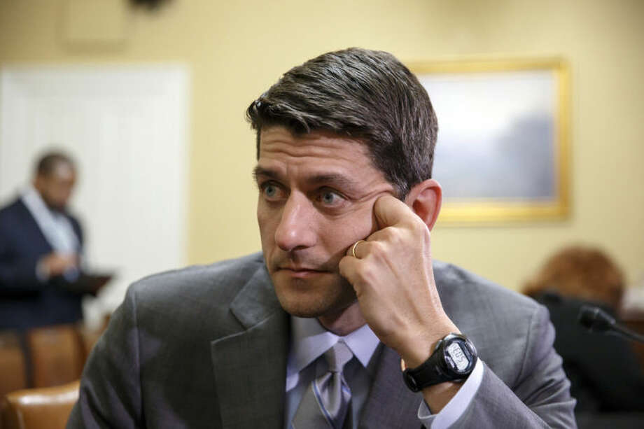 House Budget Committee Chairman Paul Ryan, R-Wis., goes before the House Rules Committee for final work on his budget to fund the government in fiscal year 2015, at the Capitol in Washington, Monday, April 7, 2014. (AP Photo/J. Scott Applewhite)