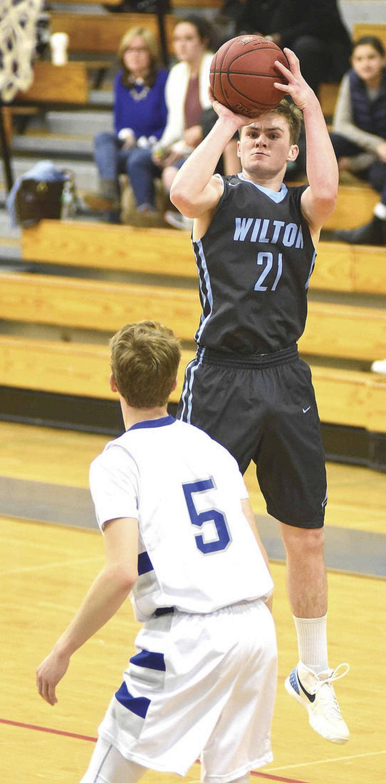 Hour photo/John Nash - Jack Williams of Wilton is The Hour's boys basketball All-Area MVP for 2016.