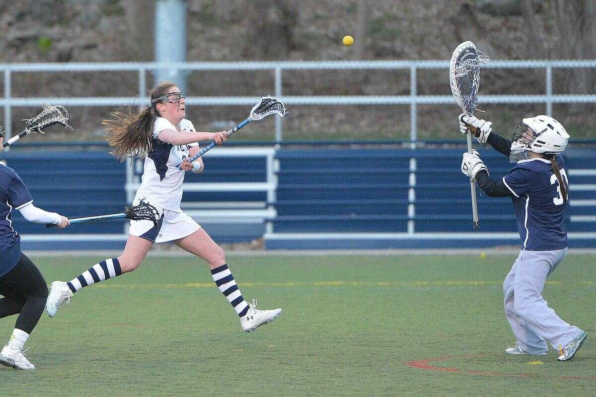 Hour Photo/Alex von Kleydorff Wiltons #28 Margaret Smith shoots and scores vs Staples