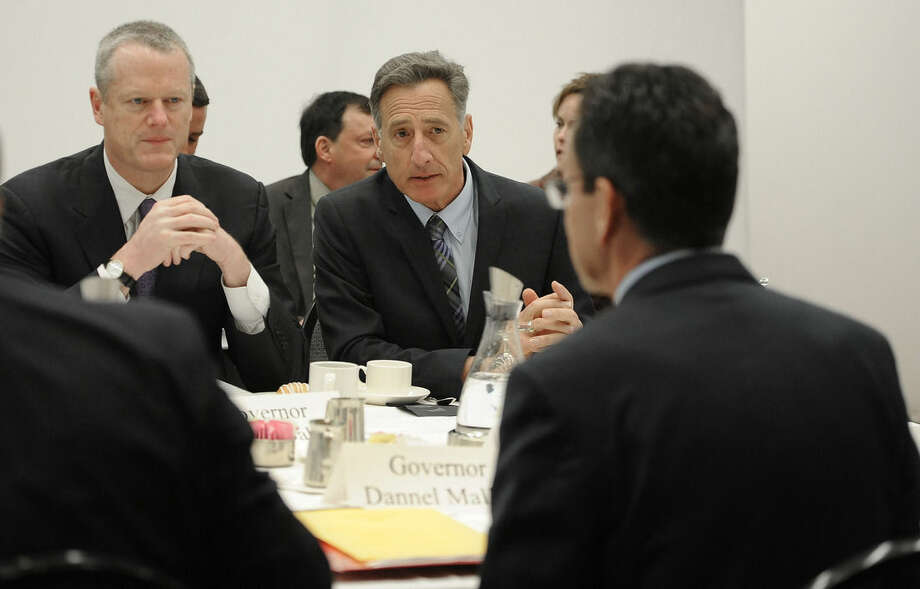Vermont Gov. Peter Shumlin, center, talks with Connecticut Gov. Dannel P. Malloy, right, as Massachusetts Gov. Charlie Baker, left, listens during a private lunch, Thursday, April 23, 2015, in Hartford, Conn. New England's governors met Thursday to update their long-term energy strategy that increasingly relies on natural gas and efforts to build more pipelines. (AP Photo/Jessica Hill, Pool)