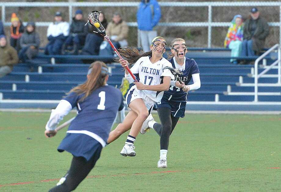 Hour Photo/Alex von Kleydorff Wilton Girls Lacrosse vs Staples