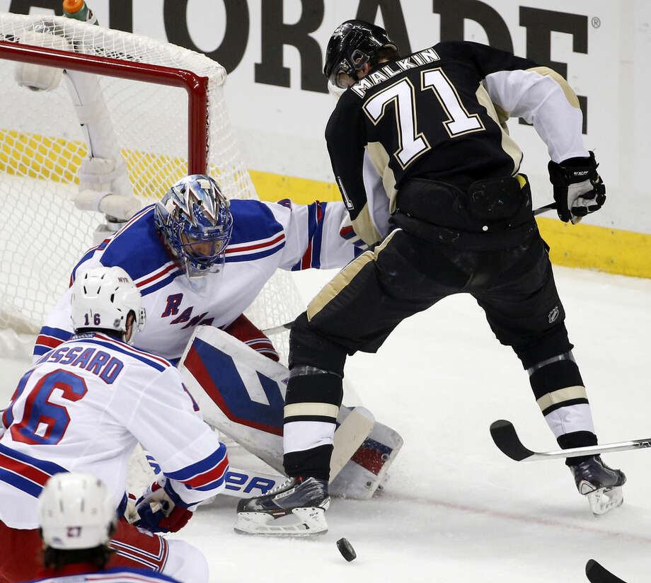 Pittsburgh Penguins' Evgeni Malkin can't get his stick on a rebound in front of New York Rangers goalie Henrik Lundqvist during the first period of a first-round NHL playoff hockey game in Pittsburgh on Wednesday, April 22, 2015. (AP Photo/Gene J. Puskar)