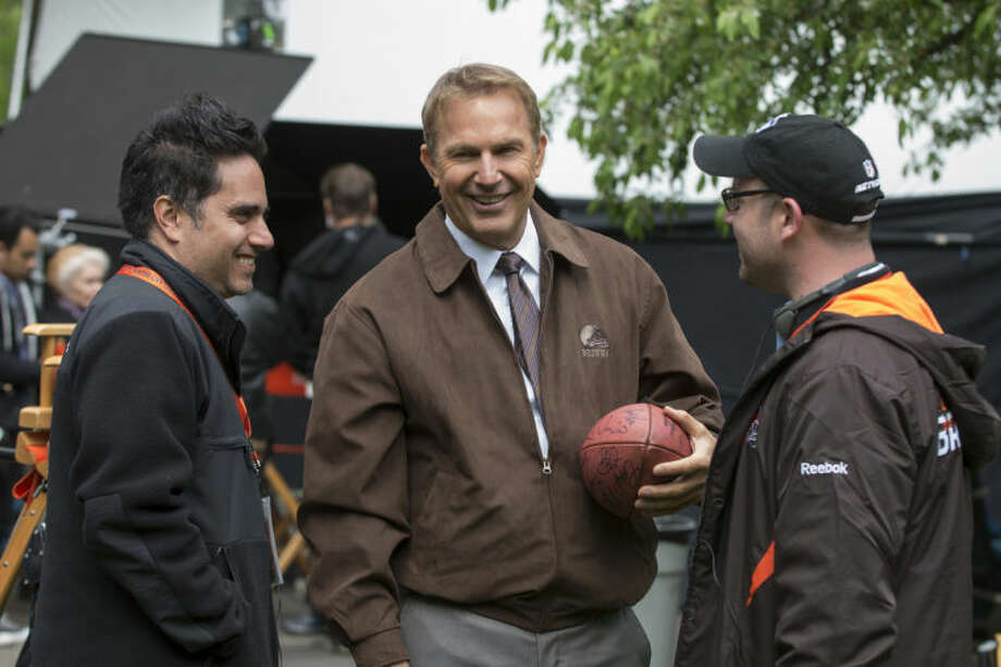 "This image released by Summit Entertainment shows Rajiv Joseph, left, Kevin Costner, center, and Scott Rothman in a scene from ""Draft Day."" (AP Photo/Summit Entertainment, Dale Robinette)"