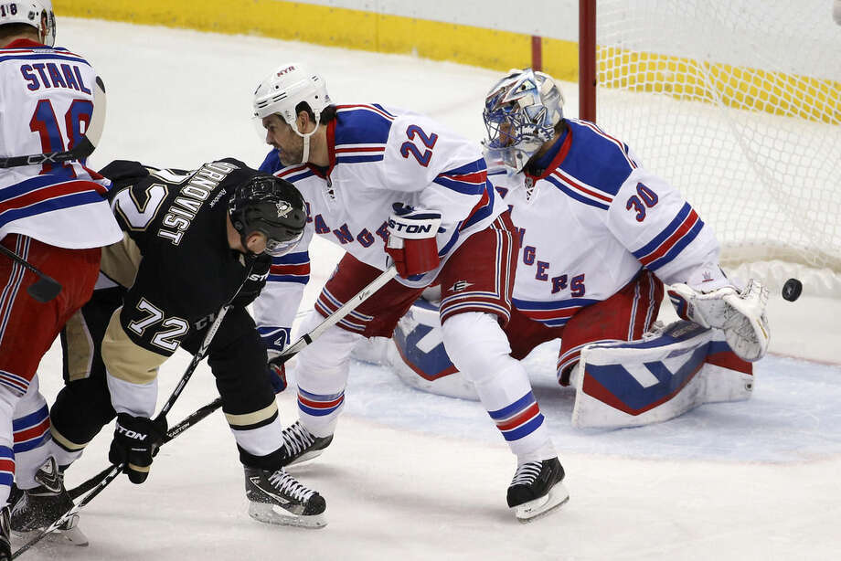 A shot by Pittsburgh Penguins' Ben Lovejoy gets past New York Rangers goalie Henrik Lundqvist (30) for a goal during the first period of a first-round NHL playoff hockey game in Pittsburgh on Wednesday, April 22, 2015. (AP Photo/Gene J. Puskar)
