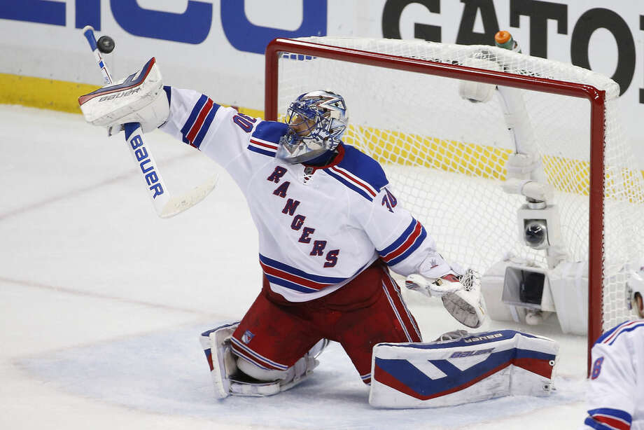 New York Rangers goalie Henrik Lundqvist (30) stops a shot during the third period of a first-round NHL playoff hockey game against the Pittsburgh Penguins in Pittsburgh on Wednesday, April 22, 2015.(AP Photo/Gene J. Puskar)