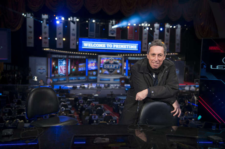 """This image released by Summit Entertainment shows director Ivan Reitman on the set of """"Draft Day."""" (AP Photo/Summit Entertainment, Dale Robinette)"""