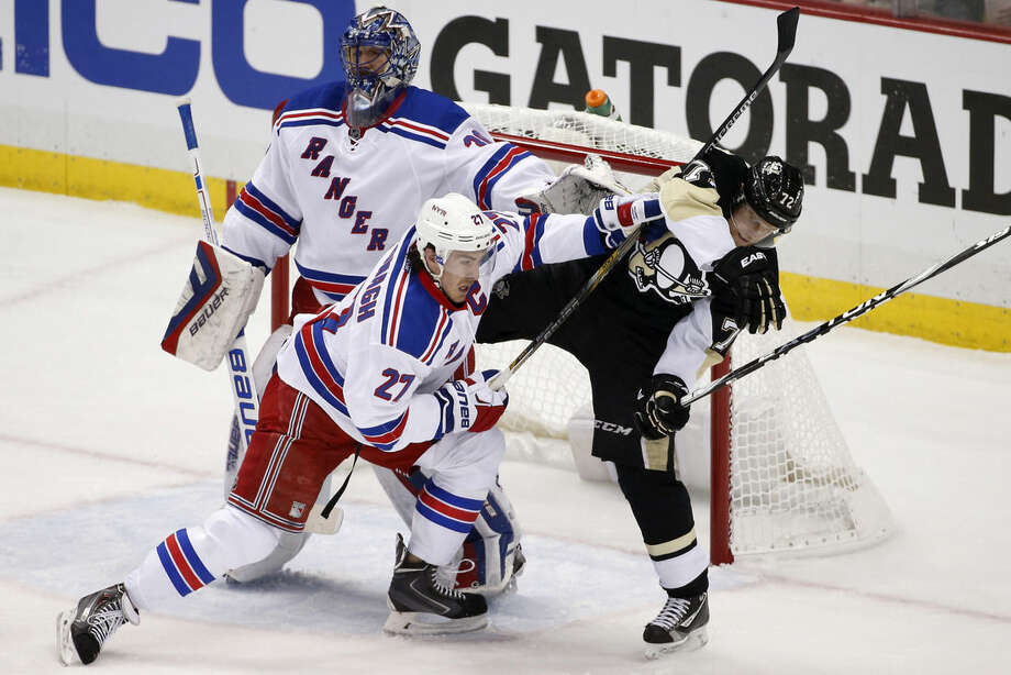 New York Rangers' Ryan McDonagh (27) checks Pittsburgh Penguins' Patric Hornqvist (72) from in front of goalie Henrik Lundqvist (30) during the first period of a first-round NHL playoff hockey game in Pittsburgh on Wednesday, April 22, 2015. (AP Photo/Gene J. Puskar)