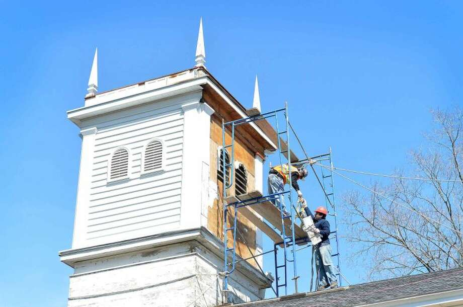 Hour Photo/Alex von Kleydorff Work begins on removal of vinyl siding from the Bell Tower on the Old Norwalk Town House in Mill Hill Historic Park. Built in 1835 and maintained by the Norwalk Historical Society, the work will reveal the origional sized louvers so the bell can be better heard and the new wood facade will better fir its historical presence.
