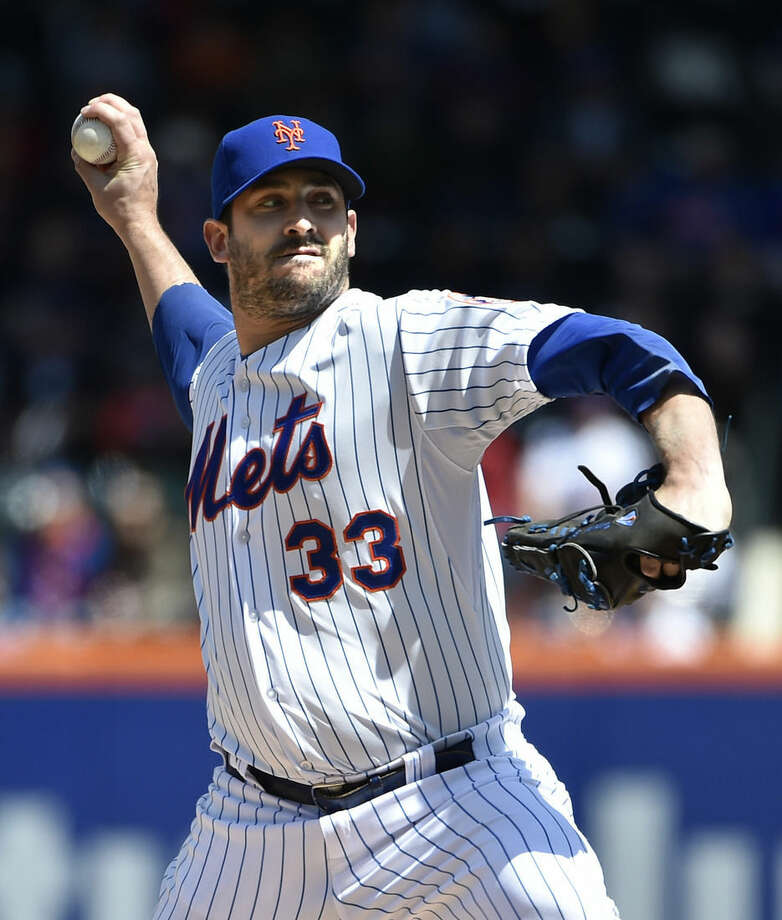New York Mets starter Matt Harvey (33) pitches against the Miami Marlins in the first inning of a baseball game at Citi Field on Sunday, April 19, 2015, in New York. The Mets won 7-6. (AP Photo/Kathy Kmonicek)