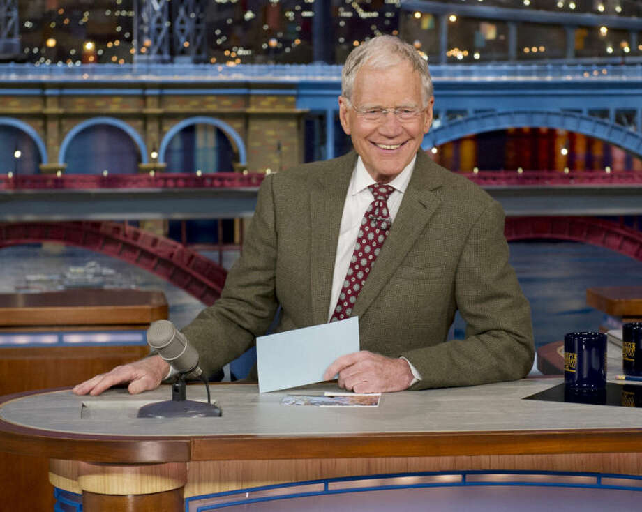 """Ap photoIn this April 3, 2014 file photo provided by CBS, David Letterman, host of the """"Late Show with David Letterman"""" is seated at his desk in New York."""