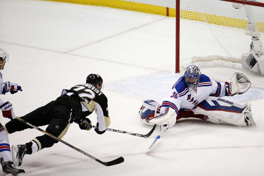 New York Rangers goalie Henrik Lundqvist (30) stops a shot by Pittsburgh Penguins' Patric Hornqvist during the third period of a first-round NHL playoff hockey game in Pittsburgh Wednesday, April 22, 2015.(AP Photo/Gene J. Puskar)