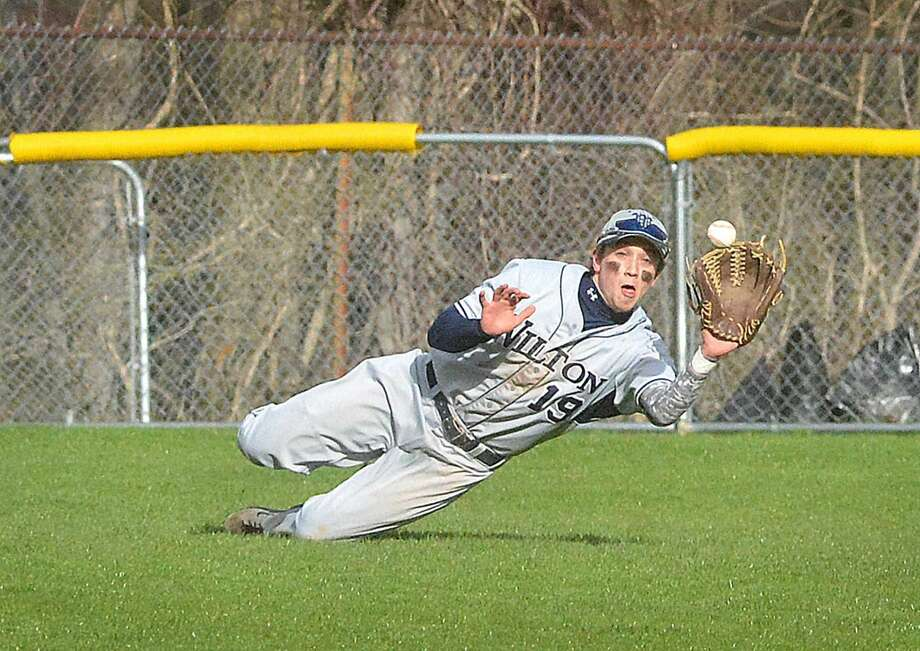 Wilton's Scott Shouvlin makes a diving catch to steal a hit against Staples on Friday. (Hour photo/Alex von Kleydorff)