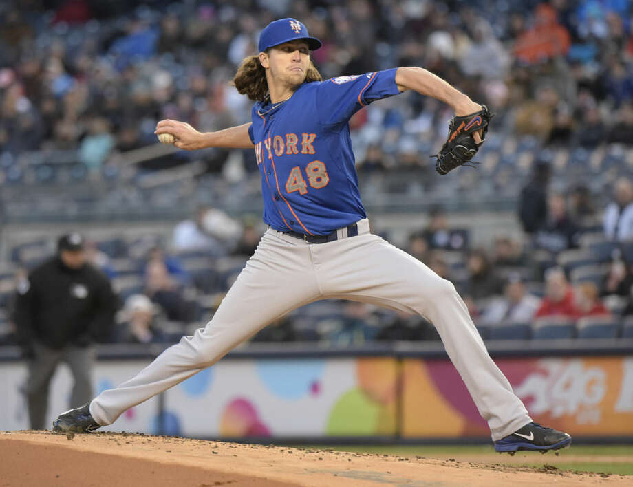 New York Mets pitcher Jacob deGrom delivers the ball to the New York Yankees during the first inning of an interleague baseball game Friday, April 24, 2015, at Yankee Stadium in New York. (AP Photo/Bill Kostroun)
