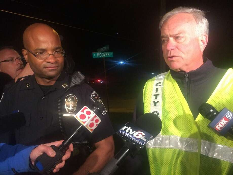 Capt. Charles Hollowell, left, of the Westfield Police Department said Thursday night April 24, 2015 that authorities don't have an exact number of injuries but are certain more than 12 were hurt. He says at least one person was critically injured after the stage gave way at Westfield High School. At right Andy Cook mayor of Westfield. (AP Photo/Lauryn Schroeder)