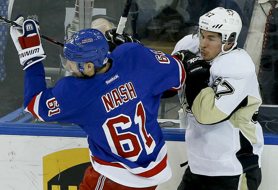 New York Rangers left wing Rick Nash (61) collides with Pittsburgh Penguins center Sidney Crosby (87) during the first period of Game 5 in the first round of the NHL hockey Stanley Cup playoffs, Friday, April 24, 2015, in New York. (AP Photo/Julie Jacobson)