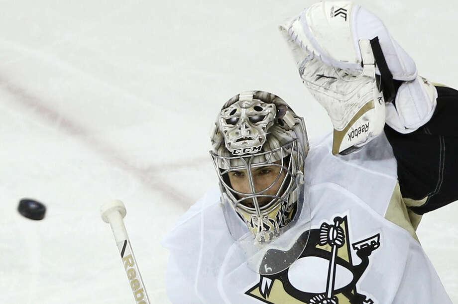 Pittsburgh Penguins goalie Marc-Andre Fleury (29) blocks a shot on goal by the New York Rangers in the third period of Game 5 during the first round of the NHL hockey Stanley Cup playoffs, Friday, April 24, 2015, in New York. (AP Photo/Julie Jacobson)