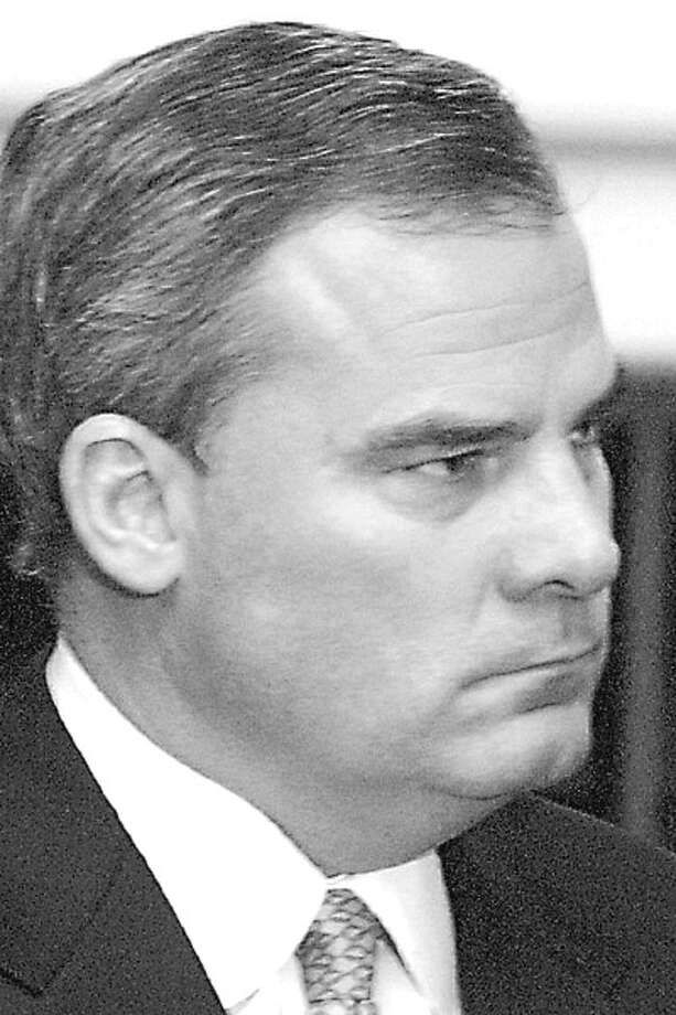 Connecticut Gov. John Rowland meets with reporters during a news conference at the Legislature Office Building, Friday, Dec. 19, 2003, in Hartford, Conn. Rowland said Friday his office did not influence the awarding of any state contracts, and said he has disclosed all the of the gifts he knows of receiving from employees and state contractors. (AP Photo/Douglas Healey) / AP