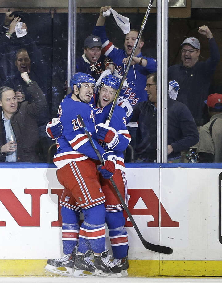 New York Rangers' Chris Kreider (20) celebrates with Derek Stepan, right, after Stepan scored a goal during the first period of Game 5 against the Pittsburgh Penguins in the first round of the NHL hockey Stanley Cup playoff, Friday, April 24, 2015, in New York. (AP Photo/Frank Franklin II)