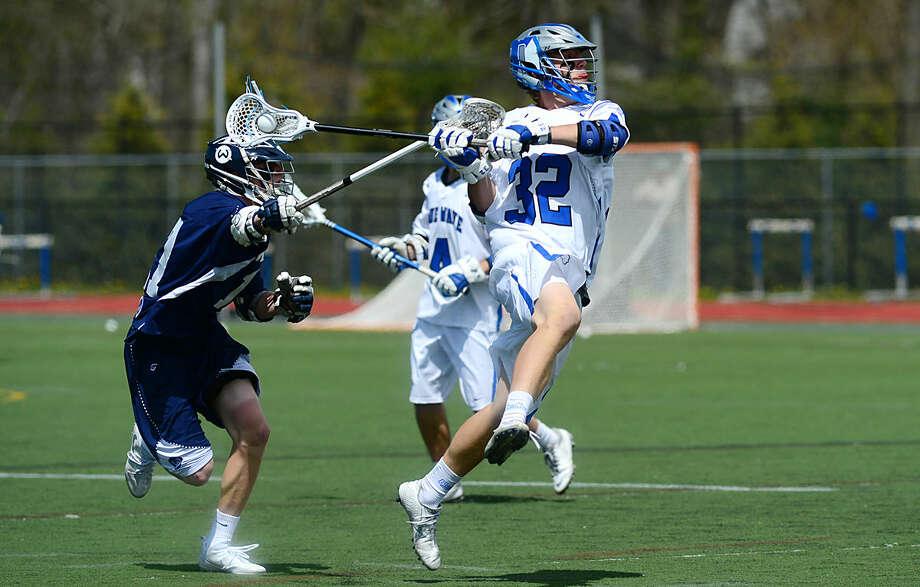 Darien High School's Boys Lacrosse player #32 Finlay Colins takes a shot against Wilton High School during their game on Saturday, April 22, 2016, at Darien High School in Darien, Conn.
