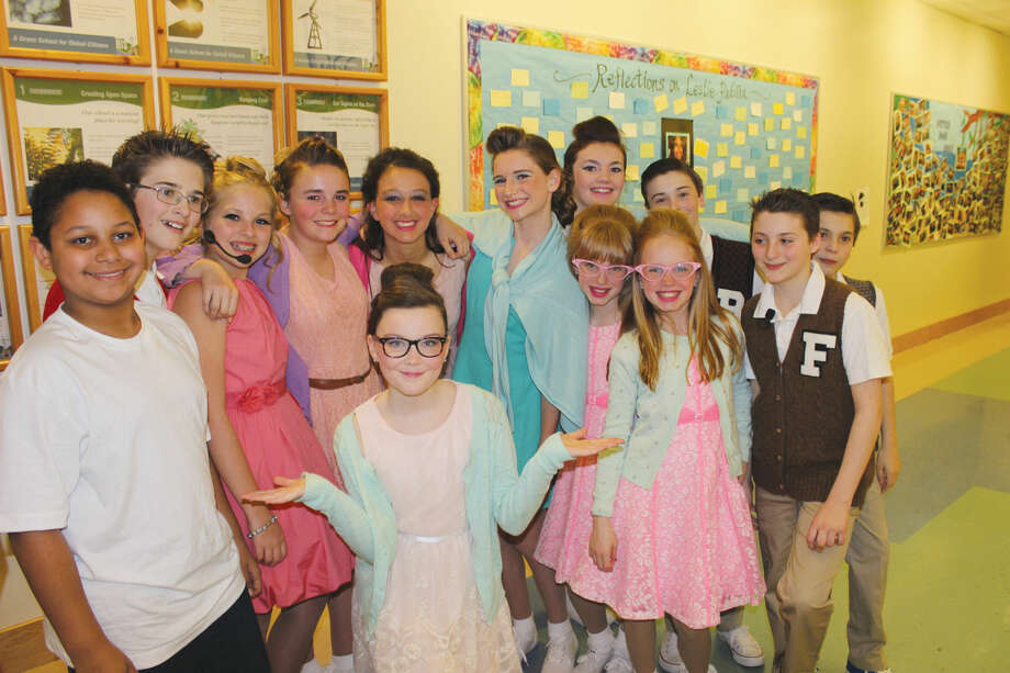 """The cast of """"Hairspray Jr."""" gathers backstage after the first night's performance."""
