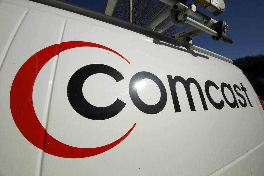 FILE - This Feb. 11, 2011 file photo shows the Comcast logo on one of the company's vehicles, in Pittsburgh. Wall Street appears increasingly convinced Comcast's $45.2 billion purchase of Time Warner Cable is dead. telling indicator is the gap between the value Comcast's all-stock bid assigned to each Time Warner Cable share and Time Warner Cable stock's current price. That was at its widest point yet Thursday, April 23, 2015, a signal that investors are giving just 20 to 30 percent odds that the deal will go through, said Nomura analyst Adam Ilkowitz. (AP Photo/Gene J. Puskar, File)