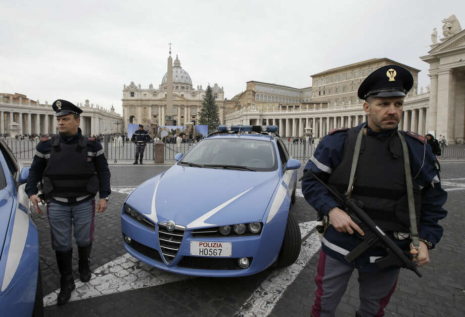 """FILE - In this Saturday, Jan. 10, 2015 file photo, Italian police officers patrol outside St. Peter's Square in Rome. Islamic extremists suspected in a bomb attack in a Pakistani market that killed more than 100 people had also planned an attack against the Vatican in 2010 that was never carried out, an Italian prosecutor said Friday. Wiretaps collected as part of investigation into an Islamic terror network operating in Italy gave """"signals of some preparation for a possible attack"""" at the Vatican, prosecutor Mauro Mura told a news conference in Cagliari, Sardinia. (AP Photo/Gregorio Borgia, File)"""