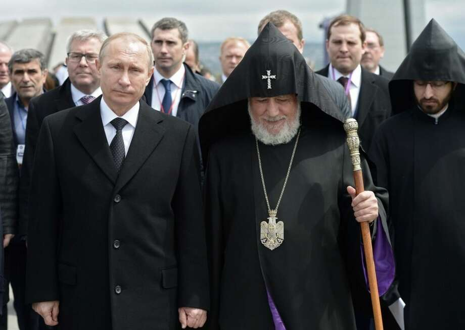 Russian President Vladimir Putin, left, and Armenian Apostolic Church leader, Catholicos Garegin II, walk to attend a memorial service in the Tsitsernakaberd Genocide memorial complex in Yerevan, Armenia, Friday, April 24, 2015. On Friday, Armenians mark the centenary of what historians estimate to be the killing of up to 1.5 million Armenians by Ottoman Turks, an event widely viewed by scholars as genocide. Turkey, however, denies the deaths constituted genocide and says the death toll has been inflated. (Alexei Nikolsky, RIA-Novosti, Kremlin Pool Photo via AP)