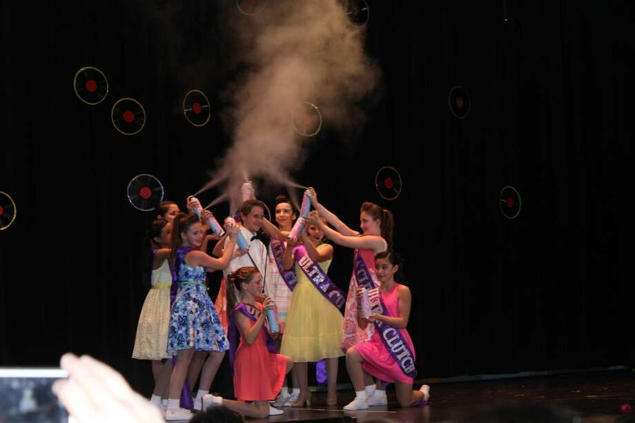 "Corny Collins (played by Zachary Tusa) is surrounded in the ""It's Hairspray"" number in the second act."