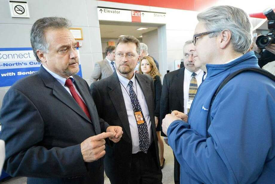 Hour Photo/Alex von Kleydorff Metro North President Joe Giulietti and Senior Management speak with commuters like Lee Cockey from Milford during Connect with Us meeting at The Stamford Transportation Center