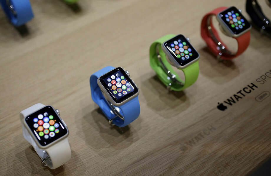 FILE - In this March 9, 2015, file photo, varieties of the new Apple Watch appear on display in the demo room after an Apple event in San Francisco. The first batch of Apple Watches will arrive in people's homes and offices Friday April 24, 2015. (AP Photo/Eric Risberg, File)