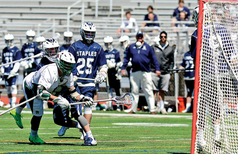 Hour photo / Erik Trautmann Norwalk's #23 Eric Cohen takes a shot on goal as the Norwalk High School Bears take on Staples High School during their boys lacrosse match up at testa Field in Norwalk Saturday.